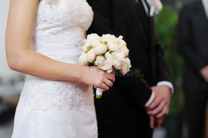 Bride holding white wedding bouquet