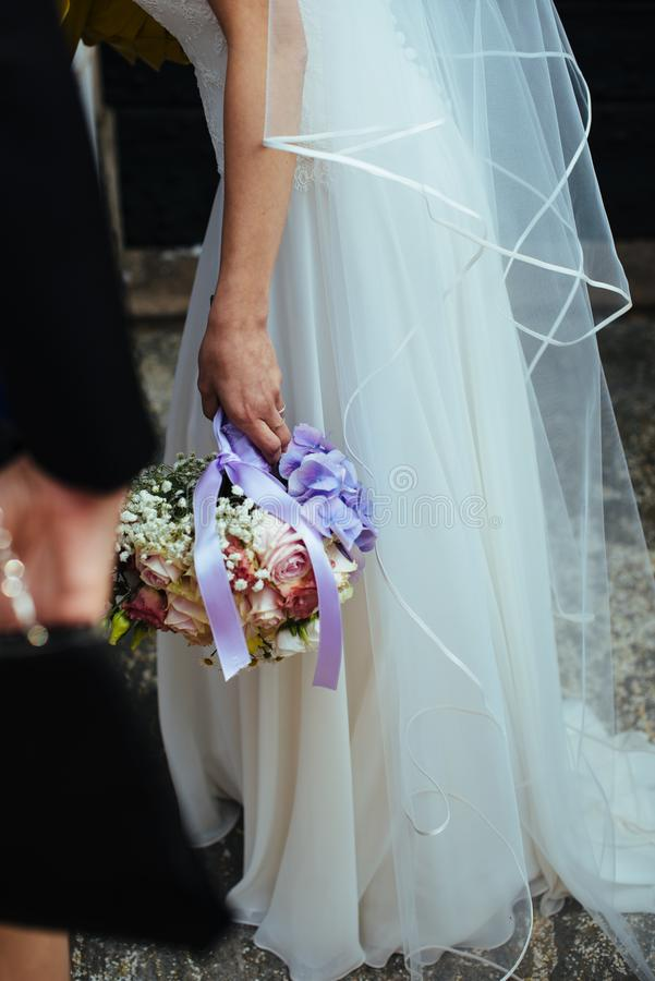 bride holds her bouquet of flowers with ivy roses daisies and hydrangeas in her wedding day royalty free stock images