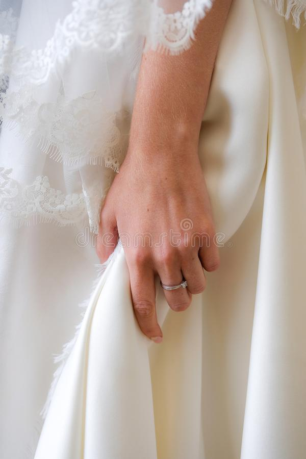 The bride holds her hand dress, close-up stock image