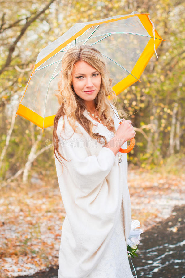 The bride holds an umbrella in his hands. royalty free stock image