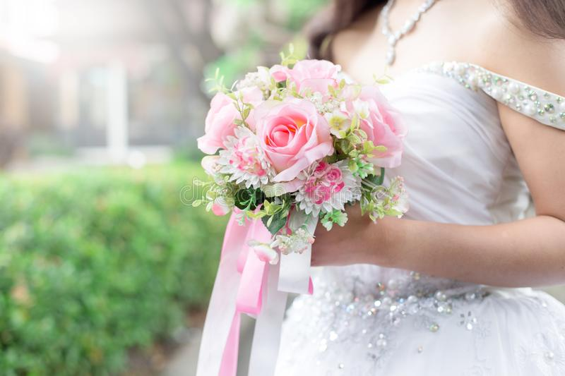 Bride holds a wedding bouquet, wedding dress, wedding ring,wedding details. This can be used as a business card background and can be used as an advertising stock photo