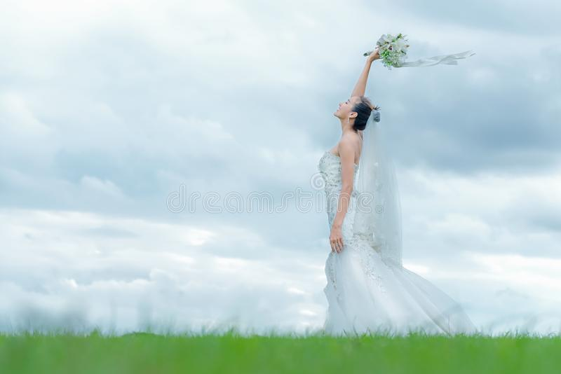 Bride holds a wedding bouquet. Bride wedding white dress in the garden royalty free stock image