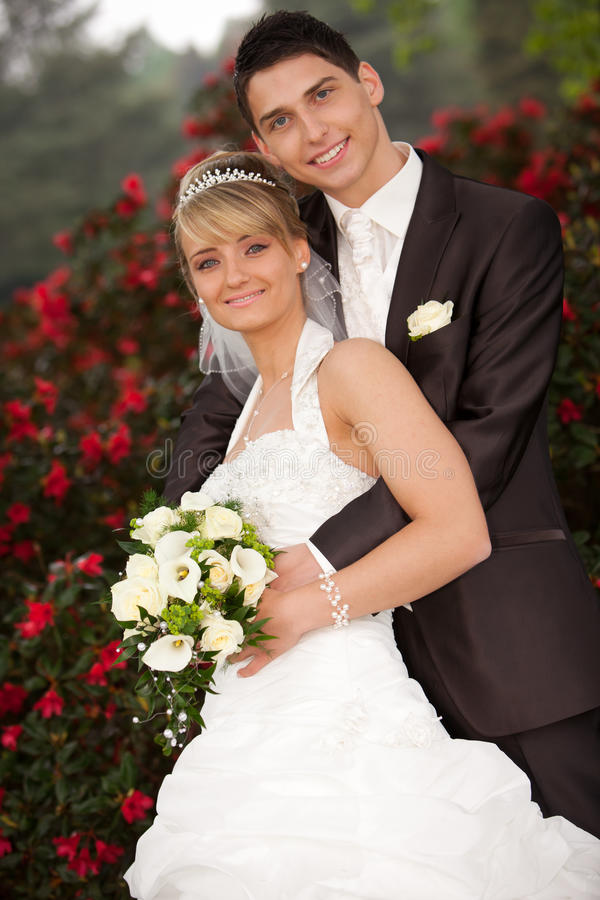 Bride leaning against groom royalty free stock images