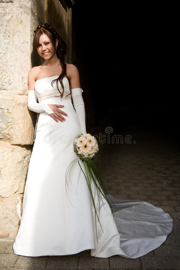 Bride leaning on wall stock image
