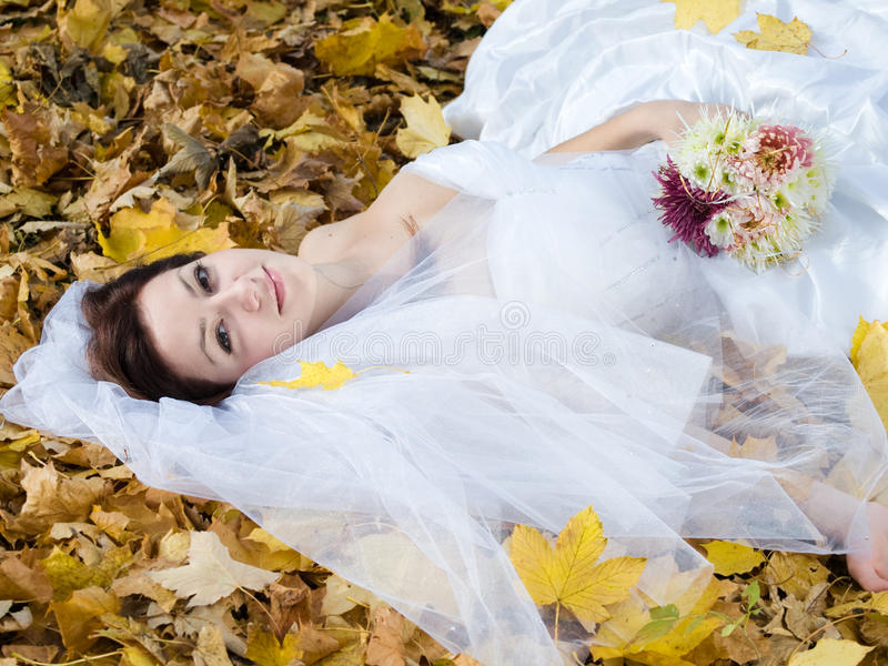 Bride on leaves stock photos