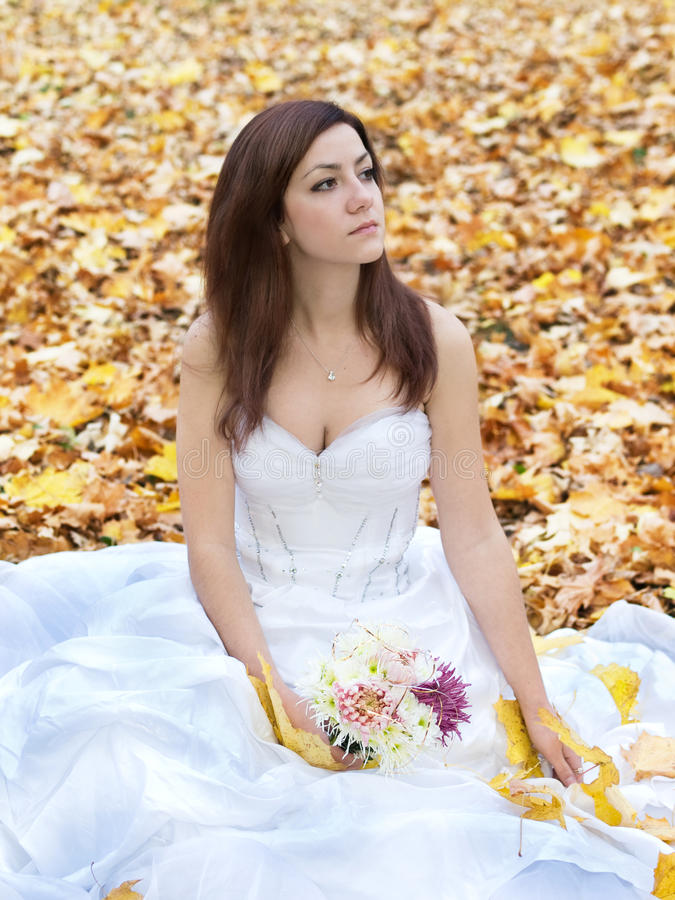 Bride on leaves stock photo