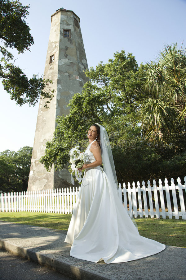 Bride with lighthouse in background. royalty free stock photos