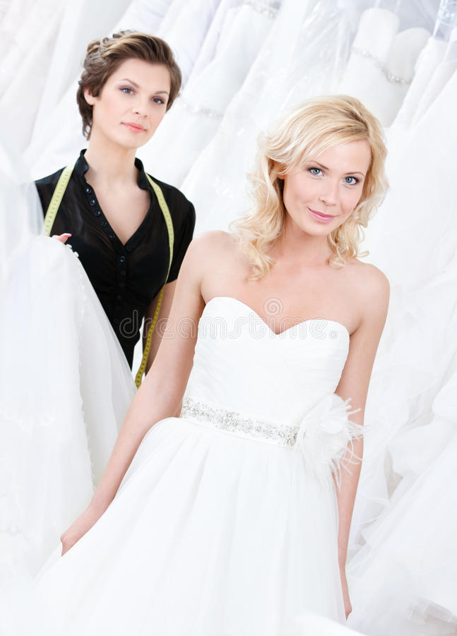 Bride likes her wedding gown stock photo