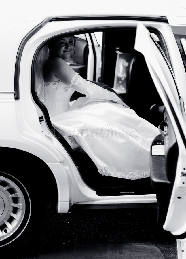 Bride in a limousine royalty free stock images