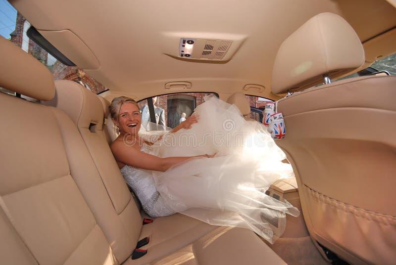 Bride in a limousine stock photos