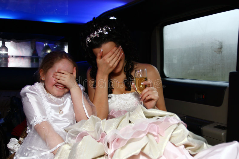 Bride and little girl stock image