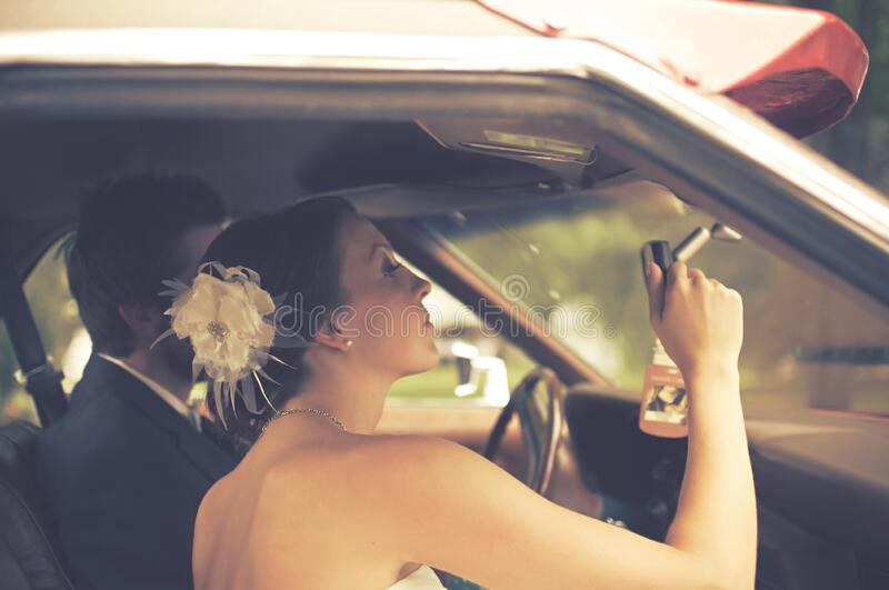 Bride looking in car royalty free stock photo
