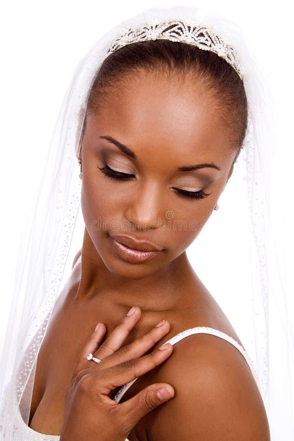 Bride looking down. stock photos