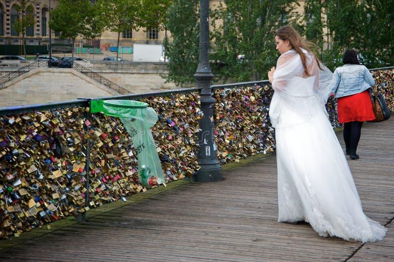 Bride looking for her love padlock