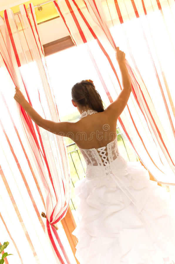 Bride looking out of window