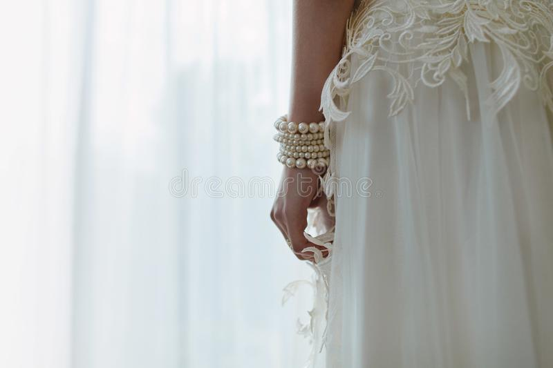 The bride, in a luxurious wedding dress royalty free stock photography