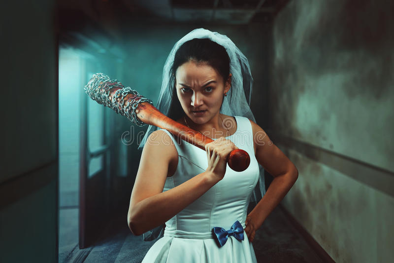 Bride maniac with baseball bat royalty free stock images