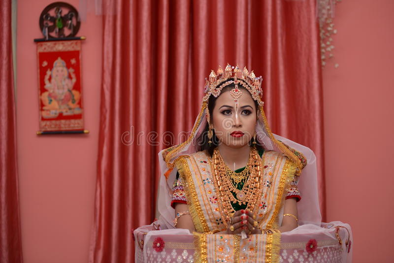 Bride in Manipuri traditional attire. Manipuri woman getting ready for wedding with a typica Meitei traditional wear- Location: Imphal Manipur India stock photos