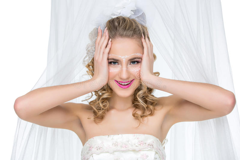 Bride with mask drawn on face stock photos