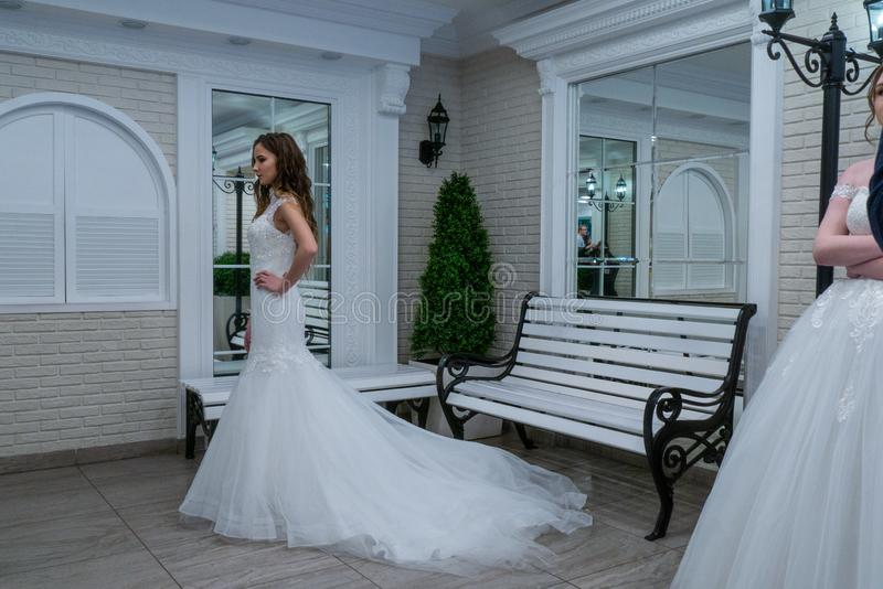 A bride model in a wedding dress. Walking aside at a retro style decorated room at the Wedding hassle 2019 exhibition took place in Kirov, Russia royalty free stock images