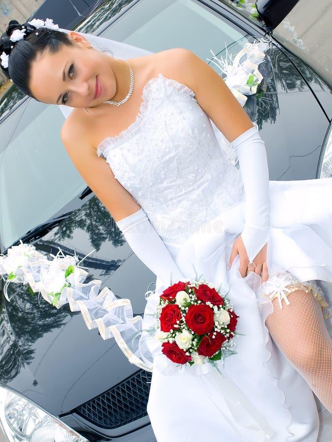 Bride near the car stock photography