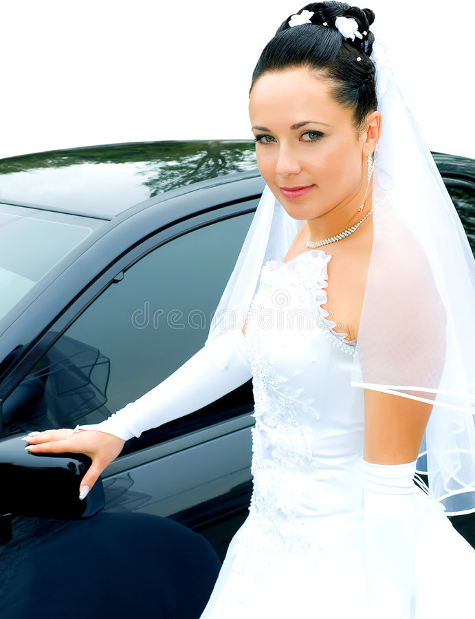 Bride near the car royalty free stock image