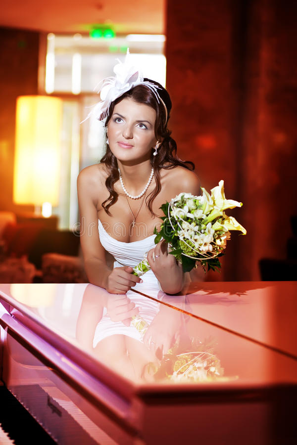 Download Bride next to the piano stock image. Image of couple - 28245541
