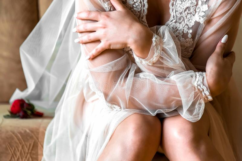 Bride in a night shirt on a wedding day. Beautiful lady in elegant panties and bra. royalty free stock images