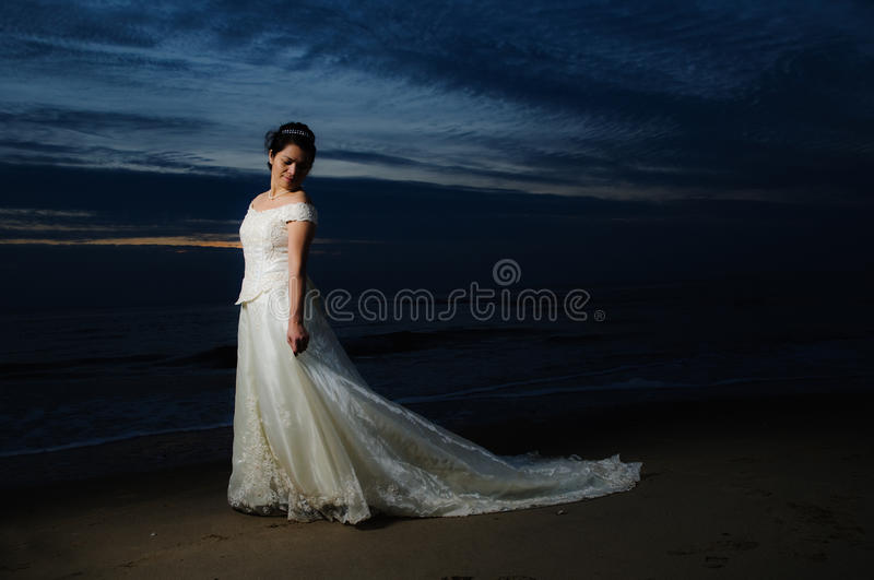 Bride at night by shore royalty free stock images