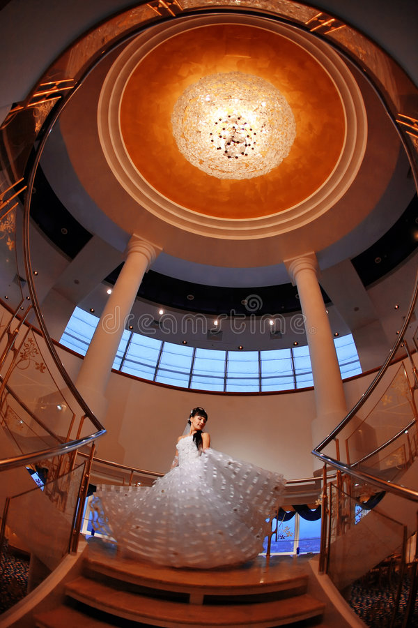 Free Bride On Stairs With Large Chandelier Over Her Royalty Free Stock Photo - 8207515