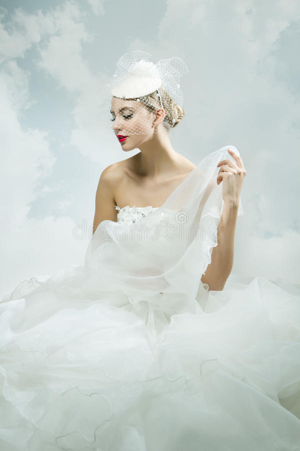 Bride over the sky background. Vintage style. Beautiful bride over the sky background. Vintage style stock photography