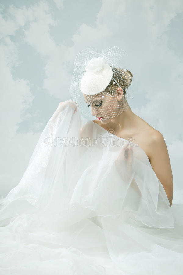 Bride over the sky background. Vintage style. Beautiful bride over the sky background. Vintage style royalty free stock photo