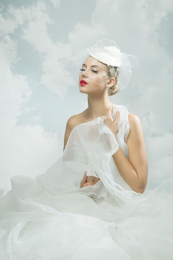 Bride over the sky background. Vintage style. Beautiful bride over the sky background. Vintage style stock photo