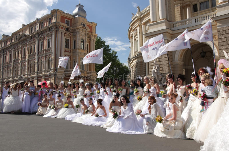 The bride parade. Odessa, Ukraine - May 23 .Group of happy excited brides at Parade of Brides.The annual event takes place in many Ukrainian and Russian cities royalty free stock photo