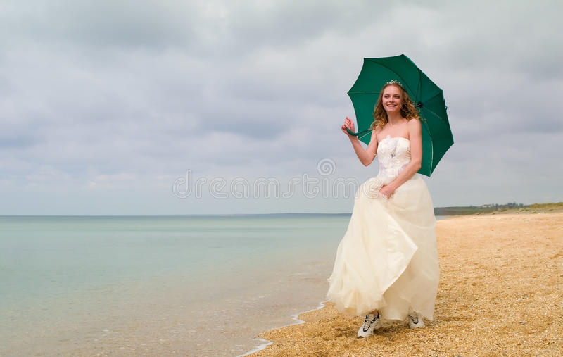 The bride with a parasol royalty free stock image