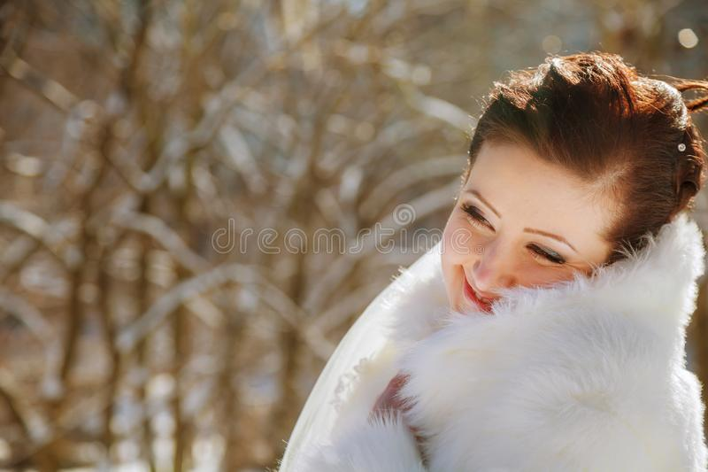 Bride in the park in winter. Portrait of young bride in winter Bride in the park in winter, woman, wedding, dress, adult, background, beautiful, beauty, bouquet stock photo