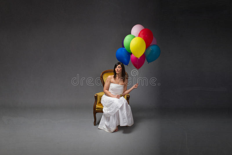 Bride party with balloon on hand. Dark background royalty free stock photo