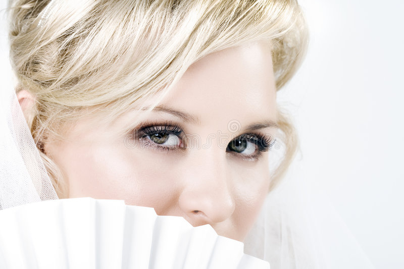 Download Bride Peeking Out From Behind A Fan Stock Photo - Image: 5611722