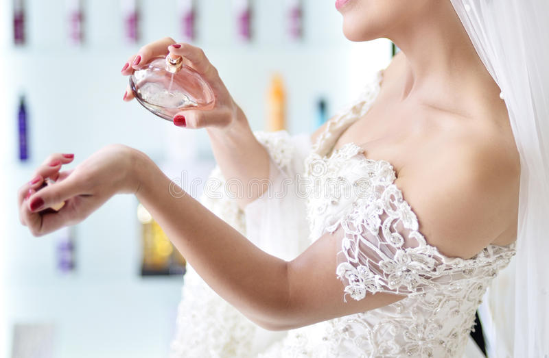 Bride and perfume stock photography