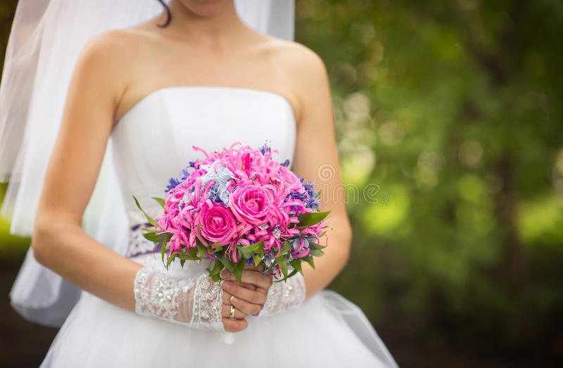 Bride and pink wedding bouquet royalty free stock image