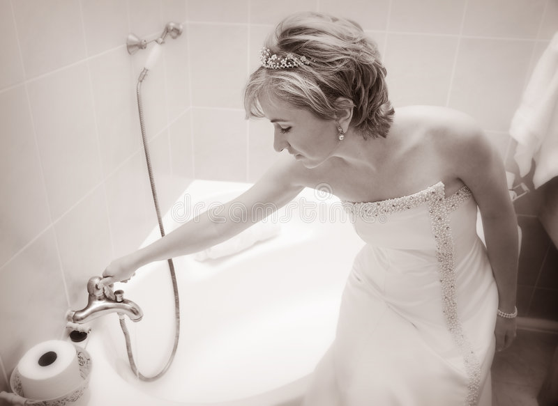 Bride preparing a bath royalty free stock photography
