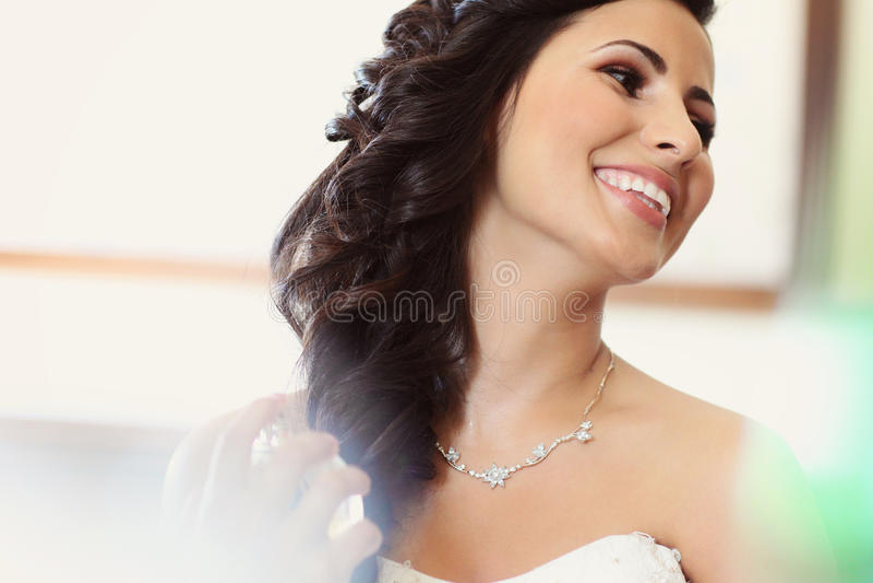Bride preparing for wedding makeup stock photo