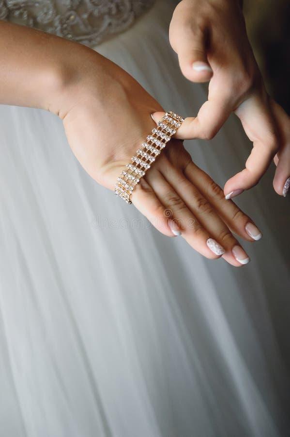Bride puts on a bracelet. royalty free stock photo