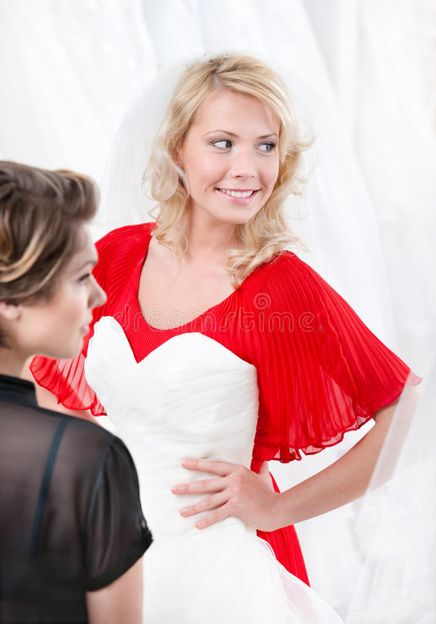 Bride puts the wedding gown to