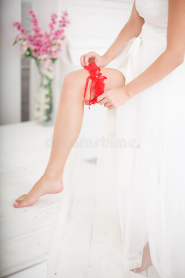 Bride Putting On Red Grater royalty free stock photos