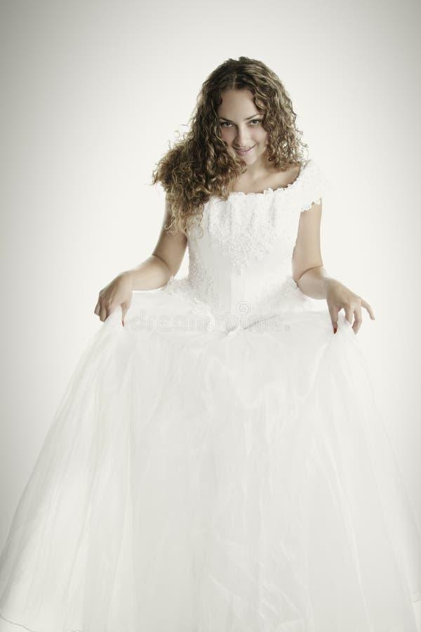 Bride Raising Dress Skirt Royalty Free Stock Photography