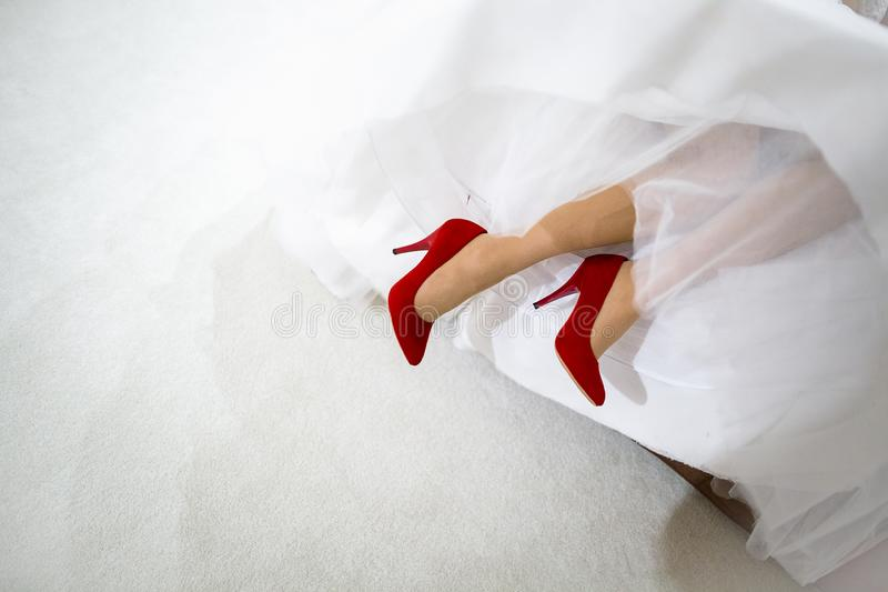 Bride in red shoes royalty free stock photo
