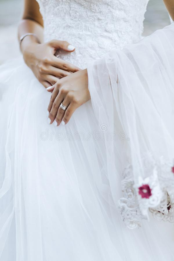 The bride and the ring are on  wedding dress. The bride and the ring are on the wedding dress royalty free stock photos
