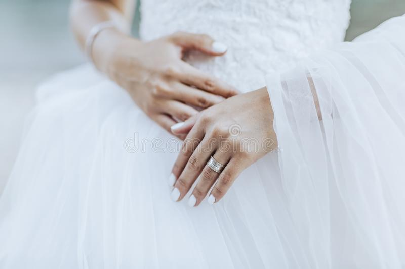 The bride and the ring are on  wedding dress. The bride and the ring are on the wedding dress royalty free stock image