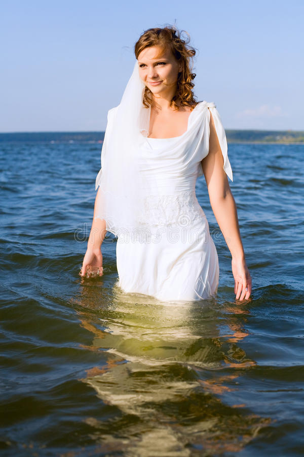 Bride in the river royalty free stock photo
